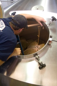 Getting the bags of wet hop tied up in the whirlpool. Temperature inside the whirlpool was 125 degrees F today!