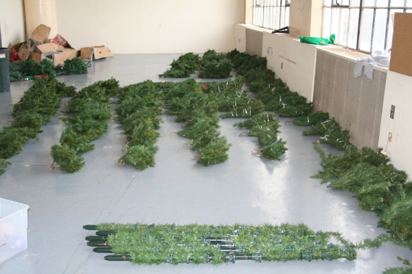 Laying out all 40 artificial trees to make sure they have all of their parts!