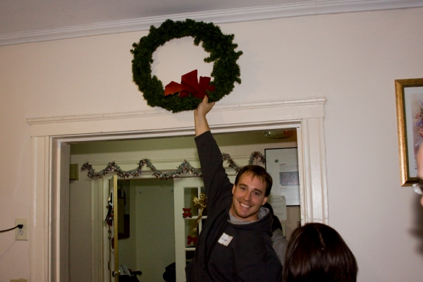 A volunteer in Boston proud of his wreath-hanging skills